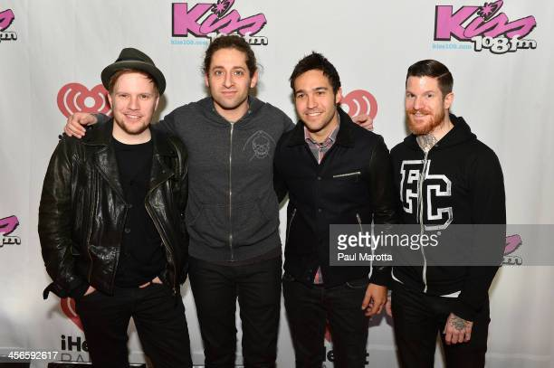 Patrick Stump Joe Trohman Pete Wentz Andy Hurley of Fall Out Boy pose backstage at KISS 108's Jingle Ball 2013 at TD Garden on December 14 2013 in...