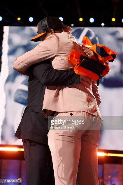 Patrick Surtain II greets NFL Commissioner Roger Goodell onstage after being selected ninth by the Denver Broncos during round one of the 2021 NFL...