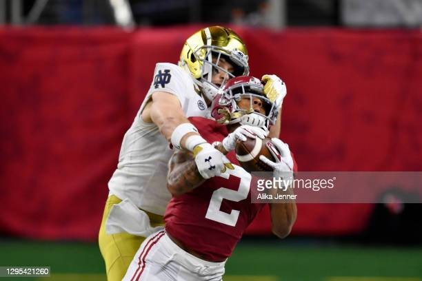 Patrick Surtain II of the Alabama Crimson Tide intercepts the ball intended for Ben Skowronek of the Notre Dame Fighting Irish during the College...