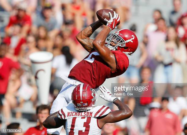 Patrick Surtain II of the Alabama Crimson Tide intercepts this reception intended for Tony Nicholson of the New Mexico State Aggies in the first half...