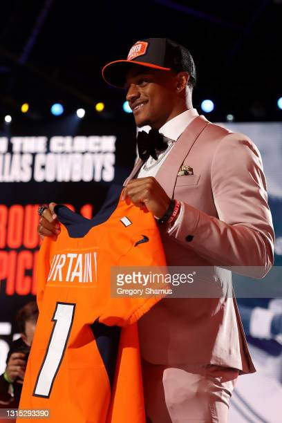 Patrick Surtain II stands onstage after being selected ninth by the Denver Broncos during round one of the 2021 NFL Draft at the Great Lakes Science...