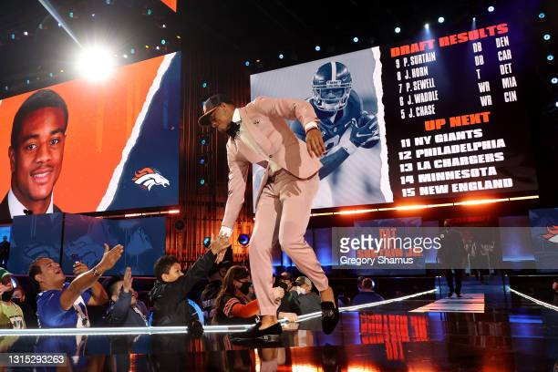 Patrick Surtain II walks onstage after being selected ninth by the Denver Broncos during round one of the 2021 NFL Draft at the Great Lakes Science...