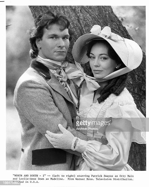 Patrick Swayze holding LesleyAnne Down in publicity portrait for the television miniseries 'North And South' 1985