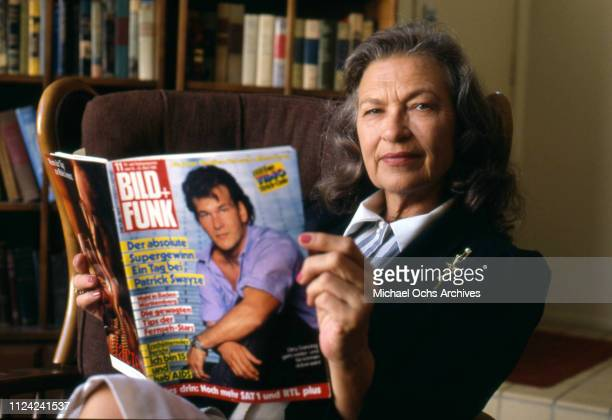 Patrick Swayze's mom Patsy Swayze poses for a portrait holding a copy of Bild Funk Magazine with her son on the cover in circa 1988
