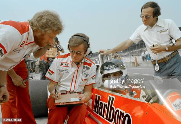 Patrick Tambay of France in the McLaren M26 talking with his engineer Alistair Caldwell during the British Grand Prix at the Brands Hatch circuit in...