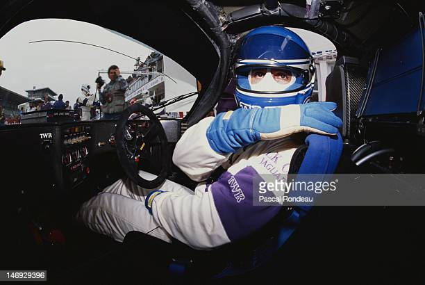Patrick Tambay of France straps himself into the TWR Silk Cut Jaguar XJR 9 LM before the start of the FIA World Sportscar Championship 24 Hours of Le...