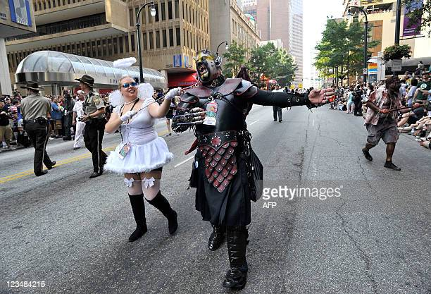 Patrick Taylor, is held on a leash by Tammy Trainer, during a Dragoncon parade on September 3 in Atlanta, Georgia. Dragoncon is a multimedia...