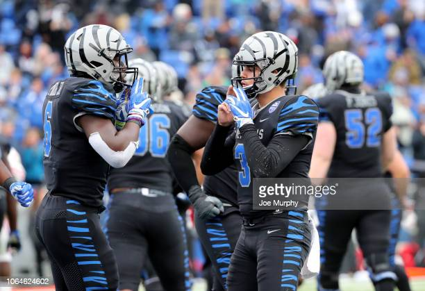 Patrick Taylor Jr. #6 and Brady White of the Memphis Tigers celebrate a touchdown against the Houston Cougars during the 2nd half on November 23,...
