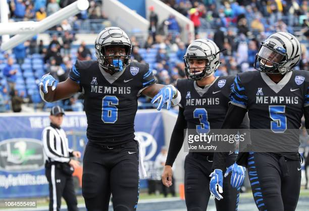 Patrick Taylor Jr. #6 of the Memphis Tigers celebrates a touchdown against the Houston Cougars during the first half on November 23, 2018 at Liberty...