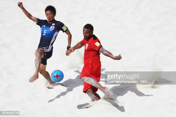 Patrick Tepa of Tahati shoots on goal in front of Tomoyuki Iino of Japan during the FIFA Beach Soccer World Cup Bahamas 2017 group D match between...