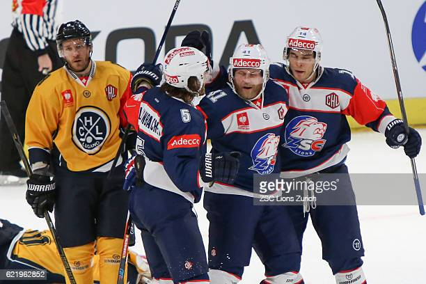 Patrick Thoresen of Zurich celebrates his goal with team mates Chris Baltisberger and Severin Blindenbacher in the second period against Lugano...
