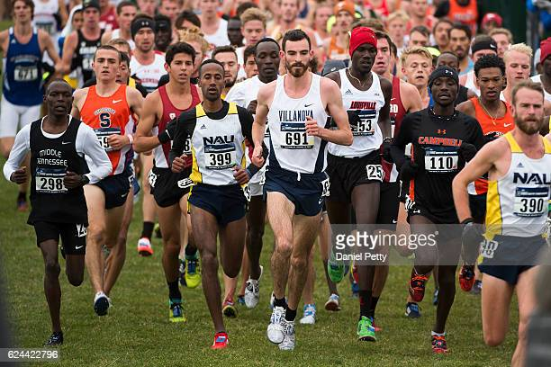 Patrick Tiernan of Villanova and Futsum Zienasellassie of Northern Arizona University race during the men's NCAA cross country championships at the...