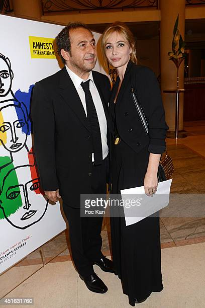 Patrick Timsit and Emmanuelle Beart attend the '20th Amnesty International France' Gala At Theatre Des champs Elysees on July 2 2014 in Paris France