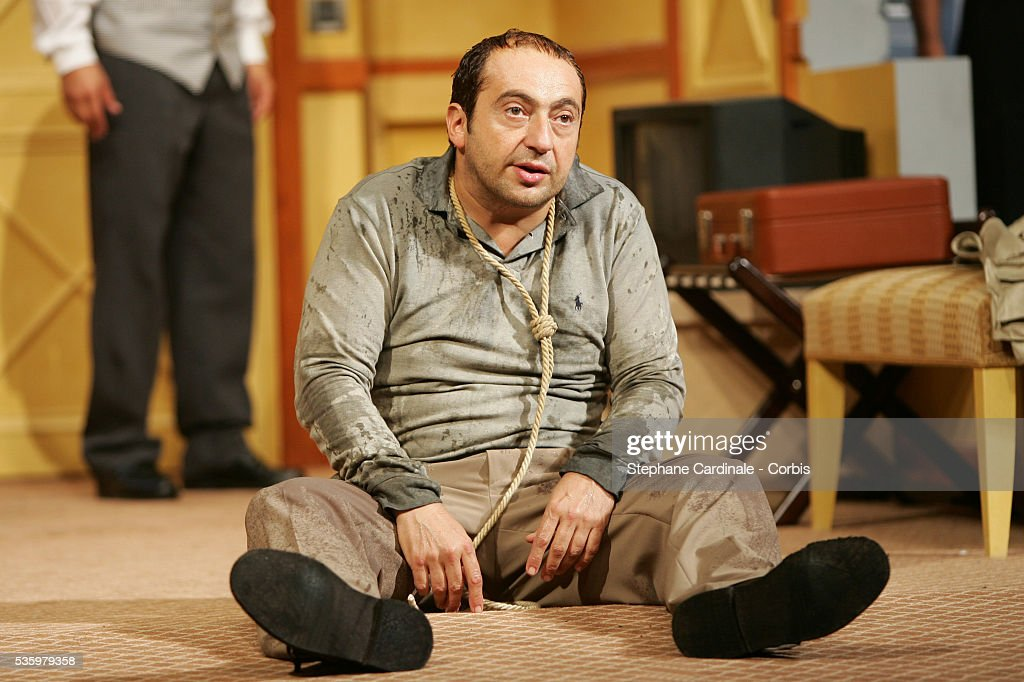 Patrick Timsit performs on stage in Francis Veber's play 'L'Emmerdeur.'