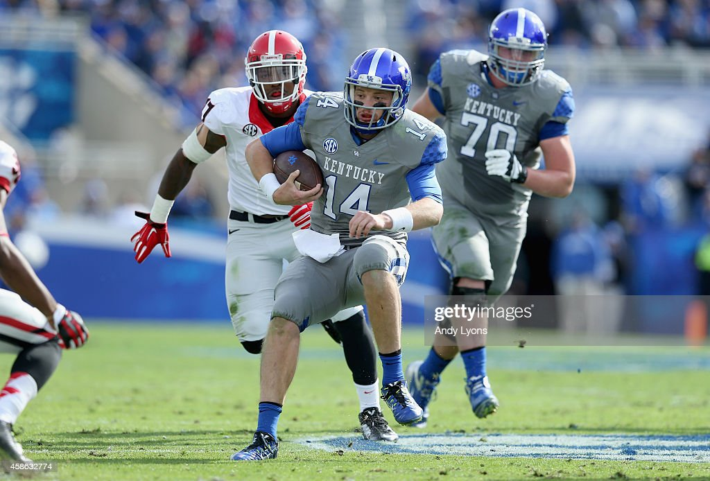 Patrick Towles #14 of the Kentucky Wildcats runs with the ball during the game against the Georgia Bulldogs at Commonwealth Stadium on November 8, 2014 in Lexington, Kentucky.