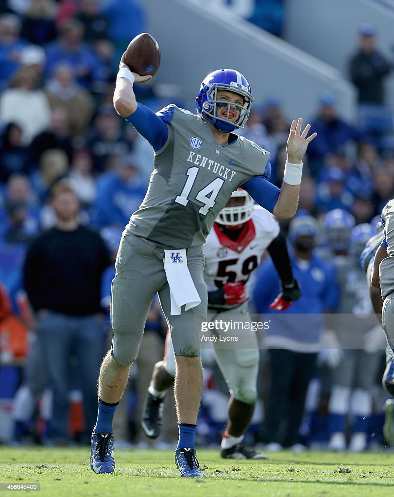 Patrick Towles #14 of the Kentucky Wildcats throws a pass during the game against the Georgia Bulldogs at Commonwealth Stadium on November 8, 2014 in Lexington, Kentucky.
