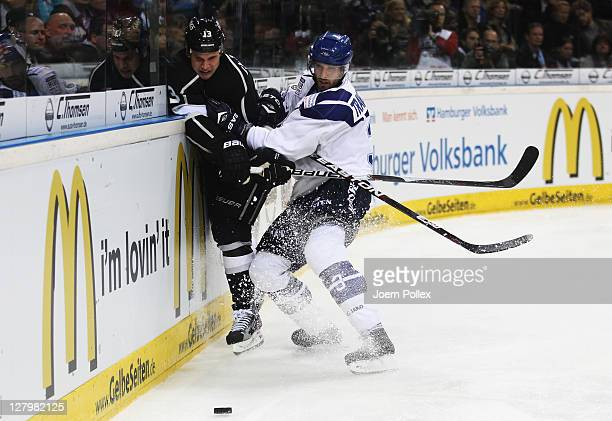 Patrick Traverse of Hamburg boards Kyle Clifford of Los Angeles during the NHL PreSeason game between Hamburg Freezers and Los Angeles Kings at the...