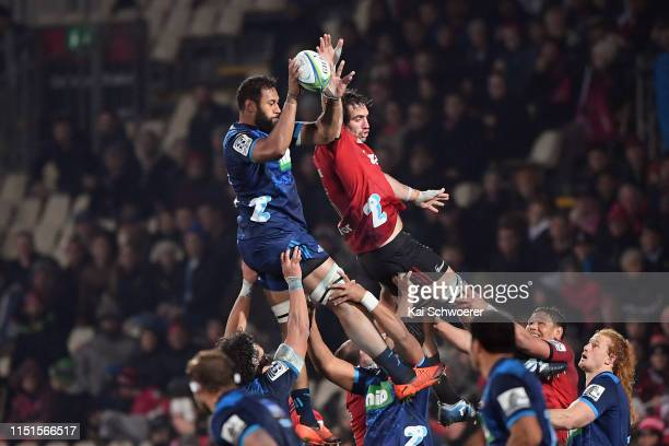 Patrick Tuipulotu of the Blues and Samuel Whitelock of the Crusaders compete for a lineout during the round 15 Super Rugby match between the...