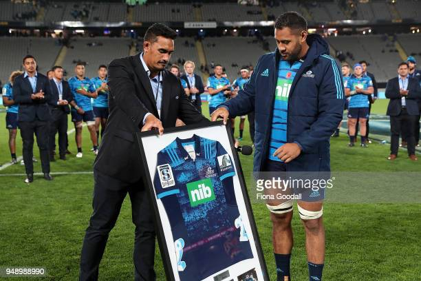 Patrick Tuipulotu of the Blues celebrates his 50th game in a presentation with Jerome Kaino of the Blues during the round 10 Super Rugby match...