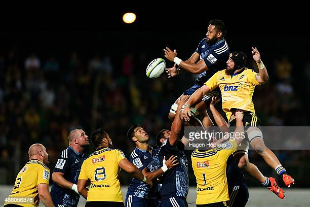 Patrick Tuipulotu of the Blues competes for a lineout ball with Blade Thomson of the Hurricanes during the round five Super Rugby match between the...