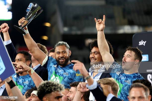 Patrick Tuipulotu of the Blues holds up the trophy following the Super Rugby Trans-Tasman Final match between the Blues and the Highlanders at Eden...