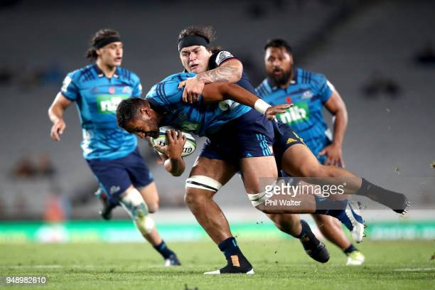 Patrick Tuipulotu of the Blues is tackled during the round 10 Super Rugby match between the Blues and the Highlanders at Eden Park on April 20 2018...