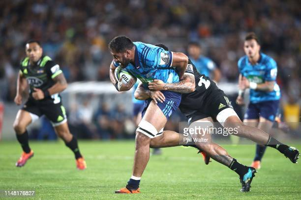 Patrick Tuipulotu of the Blues is tackled during the round 13 Super Rugby match between the Blues and the Hurricanes at Eden Park on May 10, 2019 in...