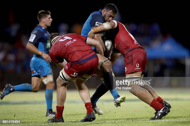 Patrick Tuipulotu of the Blues is tackled during the round 15 Super Rugby match between the Blues and the Reds at Apia Park National Stadium on June...