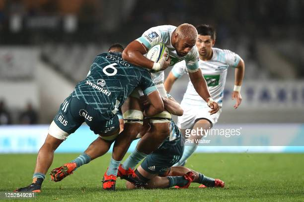 Patrick Tuipulotu of the Blues is tackled during the round 3 Super Rugby Aotearoa match between the Blues and the Highlanders at Eden Park on June...