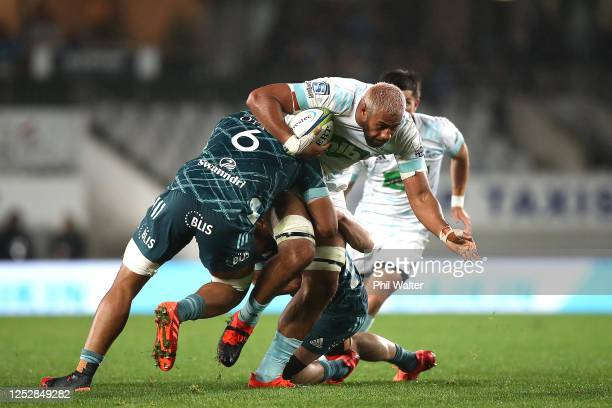 Patrick Tuipulotu of the Blues is tackled during the round 3 Super Rugby Aotearoa match between the Blues and the Highlanders at Eden Park on June 27...