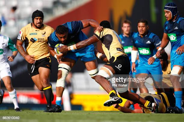 Patrick Tuipulotu of the Blues is tackled during the round six Super Rugby match between the Blues and the Force at Eden Park on April 1, 2017 in...