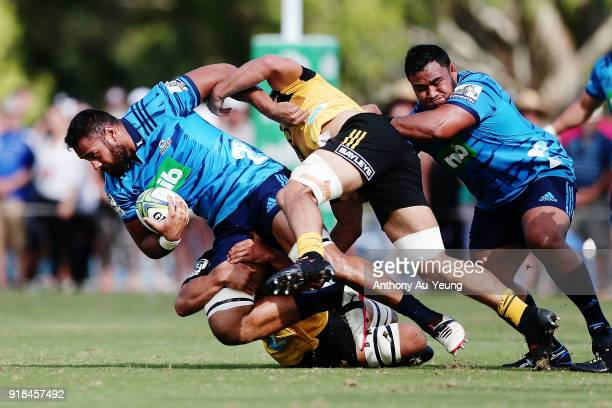 Patrick Tuipulotu of the Blues is tackled during the Super Rugby trial match between the Blues and the Hurricanes at Mahurangi Rugby Club on February...