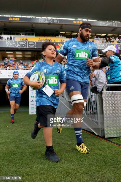 Patrick Tuipulotu of the Blues leads the team out during the round 3 Super Rugby match between the Blues and the Crusaders at Eden Park on February...