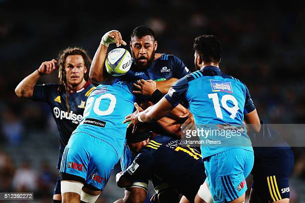Patrick Tuipulotu of the Blues looks to offload the ball during the round one Super Rugby match between the Blues and the Highlanders at Eden Park on...