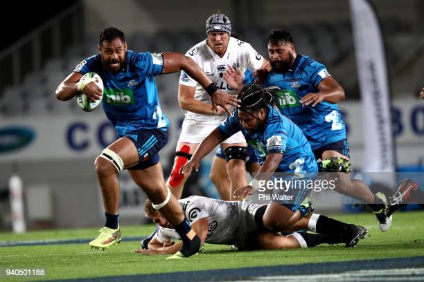 Patrick Tuipulotu of the Blues makes a break to score a try during the round sevens Super Rugby match between the Blues and the Sharks at Eden park...