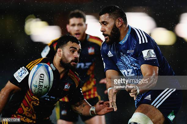 Patrick Tuipulotu of the Blues passes the ball out during the round 19 Super Rugby match between the Blues and the Chiefs at Eden Park on July 11,...