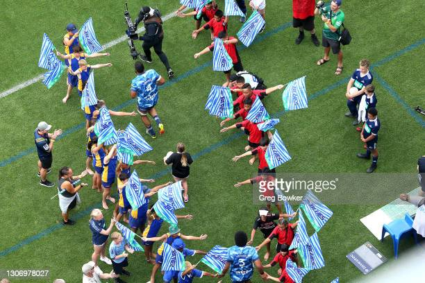 Patrick Tuipulotu of the Blues run onto the pitch at the start of the round three Super Rugby Aotearoa match between the Blues and the Highlanders at...