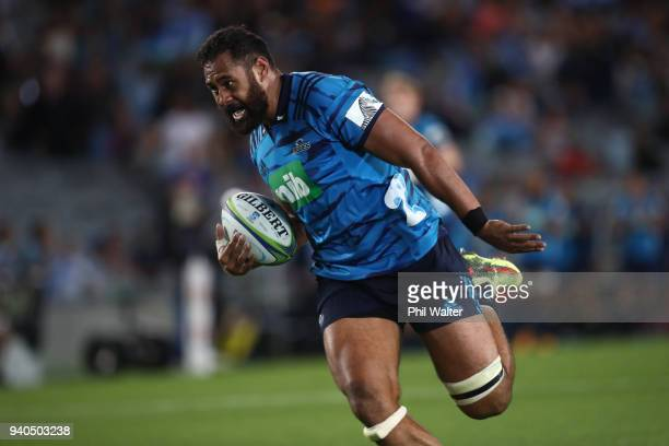 Patrick Tuipulotu of the Blues runs in to score a try during the round sevens Super Rugby match between the Blues and the Sharks at Eden park on...