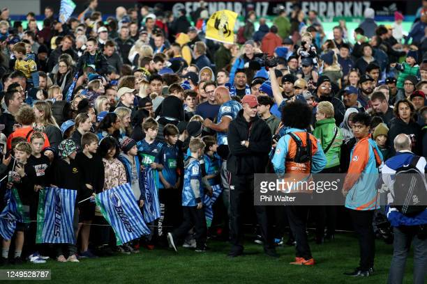 Patrick Tuipulotu of the Blues signs autographs during the round 1 Super Rugby Aotearoa match between the Blues and the Hurricanes at Eden Park on...