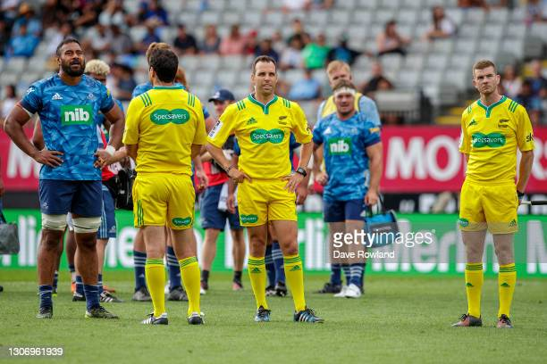 Patrick Tuipulotu of the Blues watches with Referee Mike Fraser a TMO referral during the round three Super Rugby Aotearoa match between the Blues...