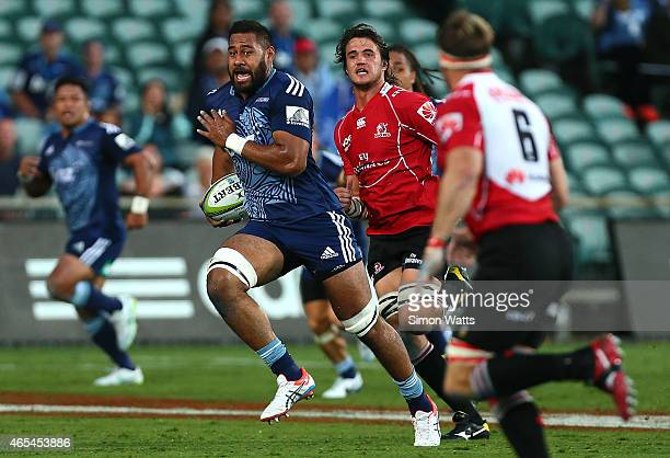 Patrick Tuipuluotu of The Blues makes a break during the round four Super Rugby match between the Blues and the Lions at QBE Stadium on March 7 2015...
