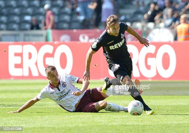 Patrick Twardzik of BFC Dynamo and Louis Schaub of FC Koeln battle for the ball during the DFB Cup first round match between BFC Dynamo and 1 FC...