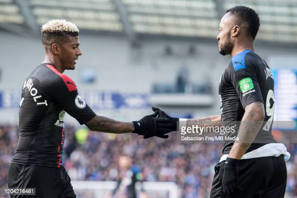 Patrick van Aanholt and Jordan Ayew of Crystal Palace during the Premier League match between Brighton Hove Albion and Crystal Palace at American...