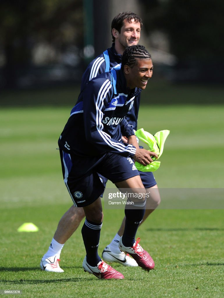 Patrick Van Aanholt and Juliano Belletti of Chelsea in action during a training session at the Cobham Training Ground on April 23, 2010 in Cobham, England.