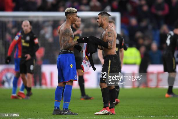 Patrick van Aanholt of Crystal Palace and DeAndre Yedlin of Newcastle United embrace at the end of the Premier League match between Crystal Palace...