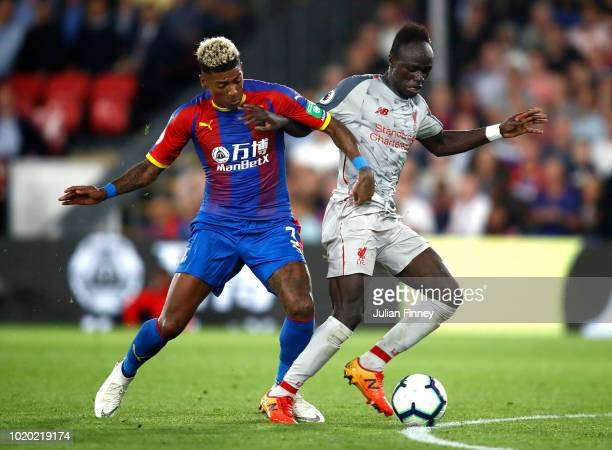 Patrick Van Aanholt of Crystal Palace and Sadio Mane of Liverpool battle for the ball during the Premier League match between Crystal Palace and...