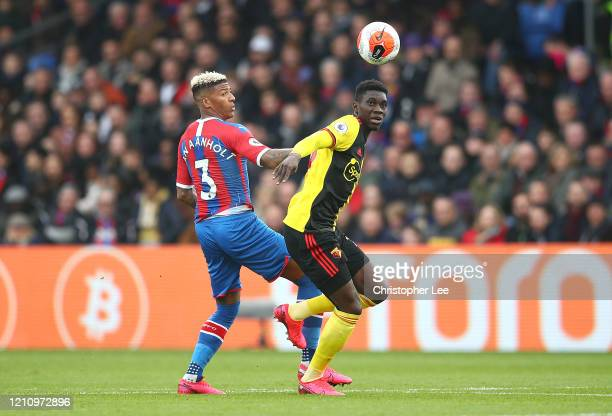 Patrick van Aanholt of Crystal Palace battles for possession with Ismaila Sarr of Watford during the Premier League match between Crystal Palace and...