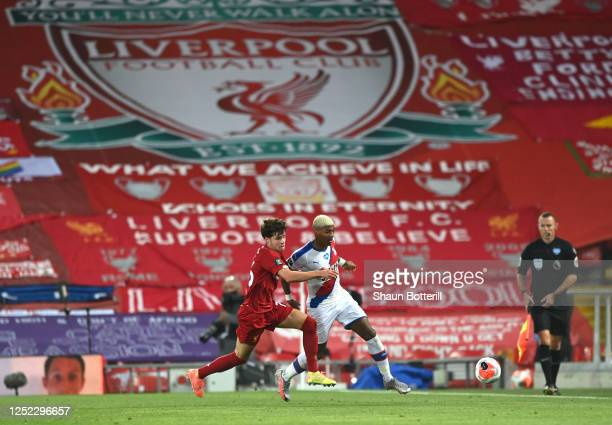 Patrick van Aanholt of Crystal Palace battles for possession with Neco Williams of Liverpool during the Premier League match between Liverpool FC and...