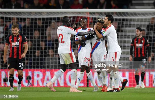Patrick Van Aanholt of Crystal Palace ceelbrates with teammates after he scores his sides first goal during the Premier League match between AFC...
