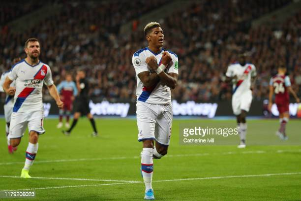 Patrick van Aanholt of Crystal Palace celebrates after he scores his sides first goal from the penalty spot during the Premier League match between...